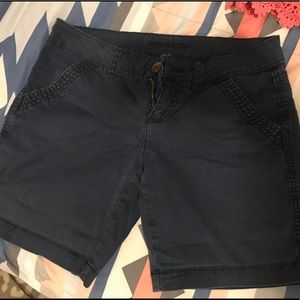 Navy blue Maurice's shorts. mid length.